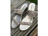 Russell & Bromley gold mules with wedge heel