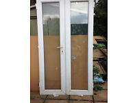 One pair of UPVC doors, NO FRAME,... but do have the hinges,...