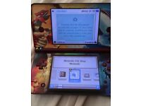 Burgundy dsi xl Nintendo with Pokemon cover and stylis