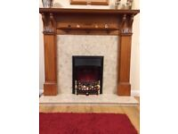 Teak fire surround with coal effect electric fire