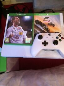 Xbox One S - 1 week old. Comes with FIFA and Forza Horizon 3. 1 controller and box. £180.
