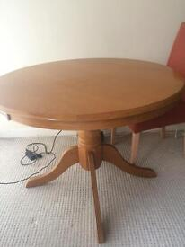 Oak effect round dining table