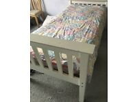 Single wooden 'NEXT' bed with mattress and pull out underbed