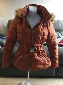 New ladies broze hooded jacket size 10