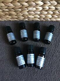 7 bottles of pure essential oils blends