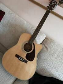 Yamaha electro-acoustic FX370C with cover.
