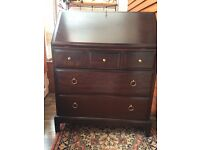 Stag Bureau dark wood good condition £45 ono and black TV stand with cable tube £15ono