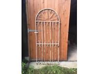 Solid steel metal arched gate. Very heavy.