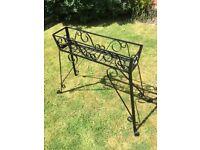 Old metal planter for patio or garden