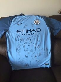 New City Shirt, hand signed by full squad.