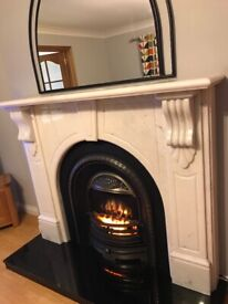 Solid marble fire place with cast iron inset
