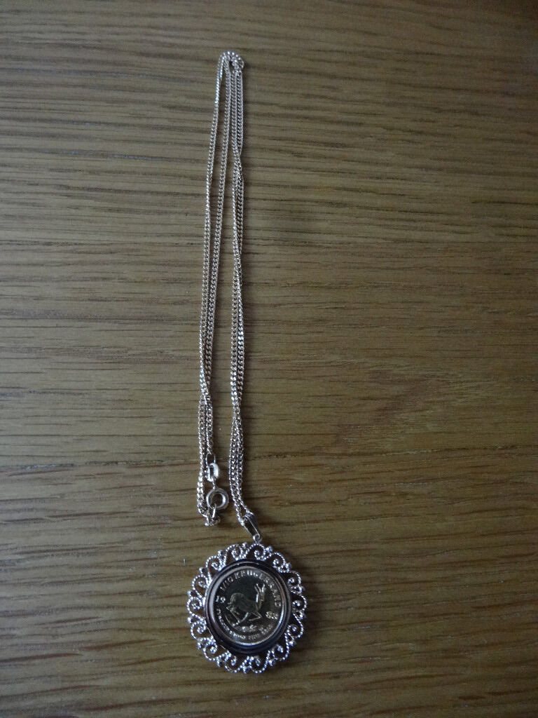 1983 KRUGERRAND 1/10 FINE GOLD COIN IN 9ct PENDANT .