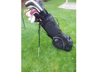 Set of Men's Right Handed Golf Clubs including self standing bag.