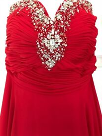 Stunning Red Prom Dress with beautiful bead bodice and matching stole.