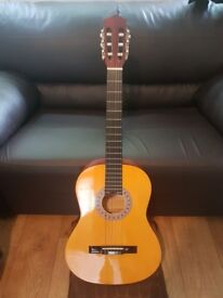 Acoustic guitar (ideal for beginners) - great condition + comes with books & pick