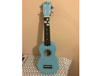 Kona blue Ukulele in excellent condition with matching case.