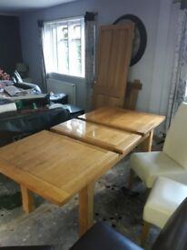 Solid oak table and 4 chairs. Very good condition. Few minor marks.