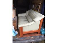 Identical twin leather and oak wood sofa couches