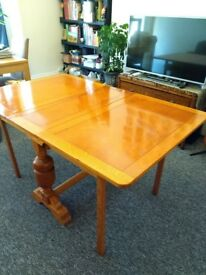 Antique fold away dinning table, seats up to 6