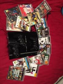 PlayStation 3 PS3 with 3 controllers and 15 games.