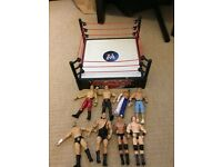 WWE wrestling ring and 8 figures for sale all in very good Condition