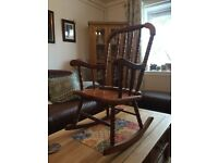 childs wooden rocking chair.Well made from good timber. just like an adults,only smaller