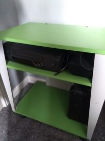 Kids green and silver shelf unit on wheels
