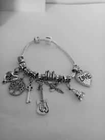 JOB LOT OR SINGLE OF BRAND NEW SILVER TONE PANDORA STYLE BRACELETS WITH CHARMS