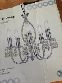 Brand new crystal chandelier in box.