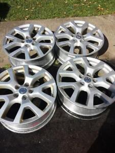 NISSAN ROGUE FACTORY OEM 18 INCH ALLOY WHEELS WITH SENSORS IN GOOD CONDITION.