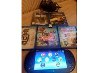 PS Vita slim with 6 Top Games.