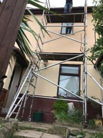 Narrow young man alloy scaffolding tower 6.2m wh