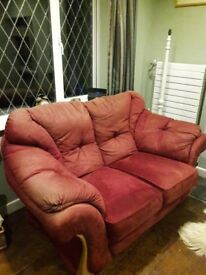 Red suede effect sofa