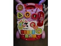 Pink baby walker with phone