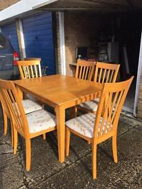 Dining table with six solid chairs