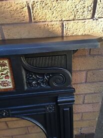 Old Cast Iron Fire place insert and grate for sale.