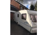 BAILEY RANGER 6 BERTH TOURING CARAVAN FIXED BUNK BEDS AND SIDE DINETTE