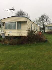 Long let static caravan