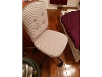 Grey and cream checked pattern chair
