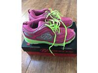 Girls pink Heelys size 5.