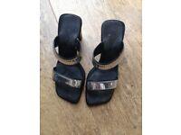 silver and black shoes size 5