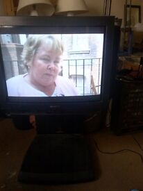 large old fashion Sony TV with side speakers and stand can deliver
