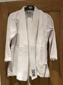 Blitz judo / karate suit with white belt. 140cm approximately age 8-10. As new