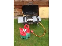 Small portable bbq with nearly full patio gas bottle