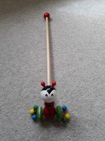 Wooden ladybird push along toy