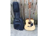 Yamaha acoustic guitar with cover