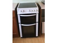 Free standing fan assisted oven with ceramic hob