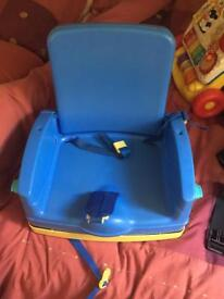 Fold away toddler booster seat with tray table.
