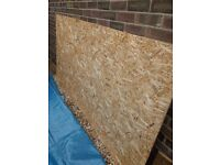 """One sheet of chip board. 8' x4' x 1/2""""."""