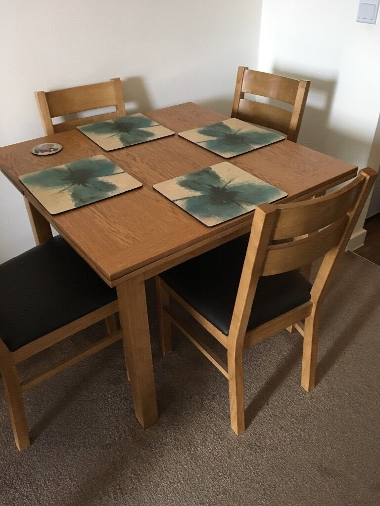 light oak dining table with 4 chairs in thatcham berkshire gumtree. Black Bedroom Furniture Sets. Home Design Ideas